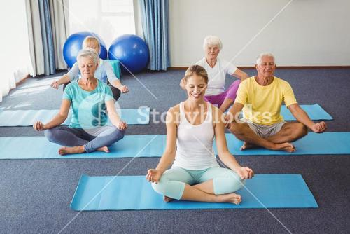 Seniors relaxing in lotus position