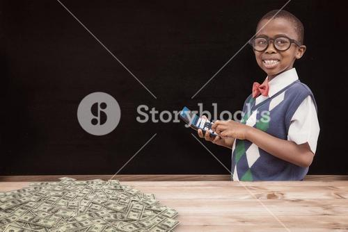 Composite image of cute pupil with calculator