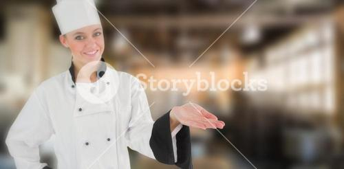 Composite image of portrait of a woman chef holding out her hand