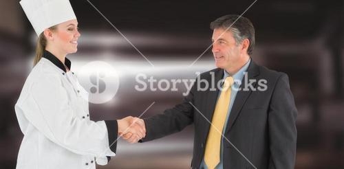 Composite image of businessman and female chef shaking hands