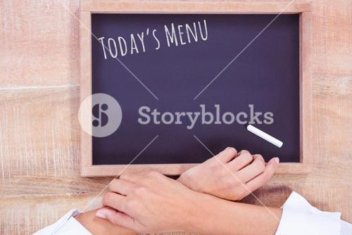 Composite image of hight angle of hand chef with blackboard