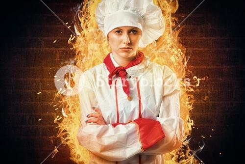 Composite image of pretty chef standing with arms crossed