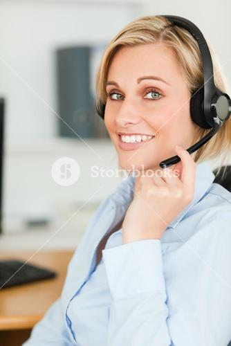 Portrait of a smiling businesswoman with headset lookinginto camera