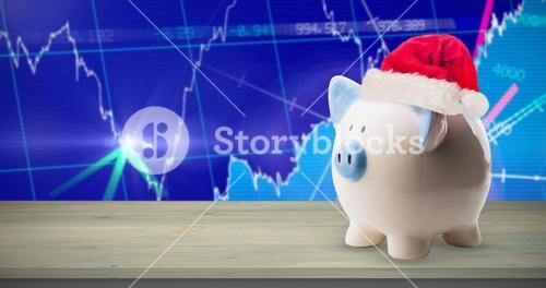 Composite image of image of money-box with christmas hat