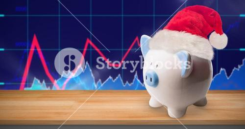 Composite image of image of a money-box with christmas hat