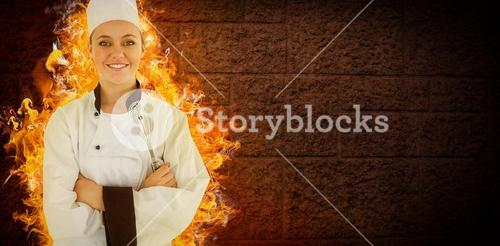 Composite image of woman chef smiling and crossed arms
