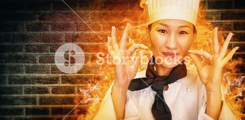 Composite image of closeup of a smiling female cook gesturing okay sign