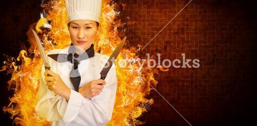 Composite image of confident female cook holding knives in kitchen