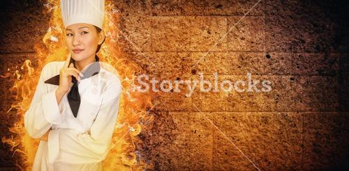 Composite image of portrait of thoughtful female cook in kitchen