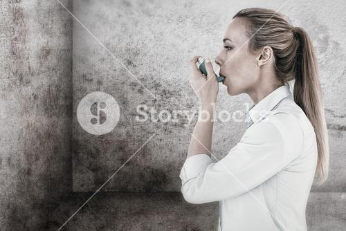 Composite image of beautiful blonde using an asthma inhaler