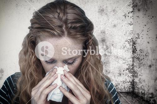 Composite image of close-up of woman blowing nose into tissue