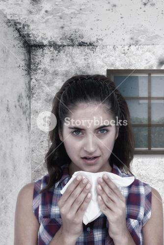 Composite image of portrait of sick woman sneezing in a tissue