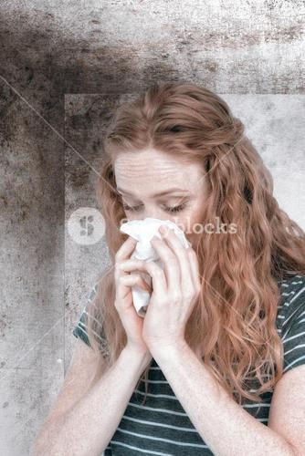 Composite image of sick blonde woman blowing her nose