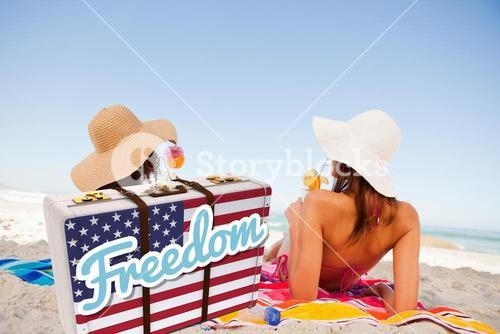 Composite image of freedom message on an american suitcase