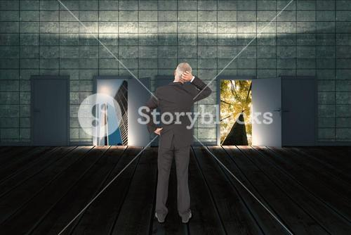 Composite image of rear view of doubtful mature businessman