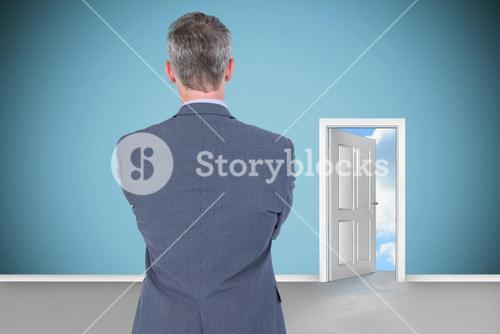 Composite image of rear view of businessman