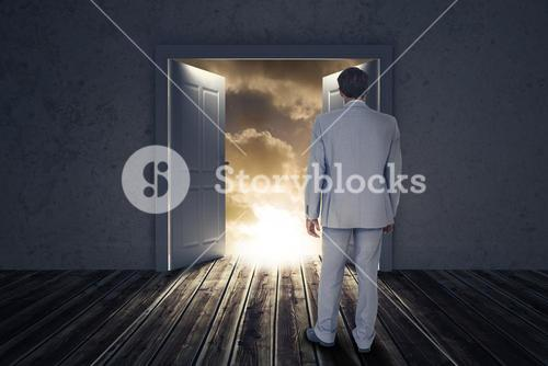 Composite image of rear view of businessman walking on white background