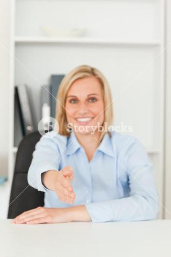 Smiling businesswoman giving hand