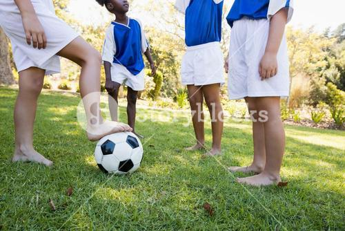 Children soccer team speaking before playing a match