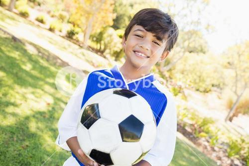 Little boy posing with balloon in hands