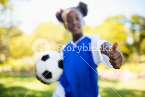 Portrait of girl with thumbs up
