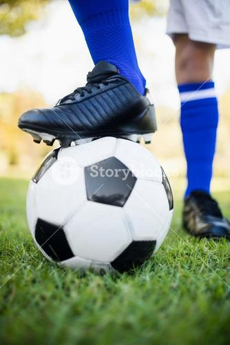 Close up view of balloon under football boots
