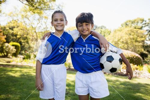 Portrait of two children smiling at camera