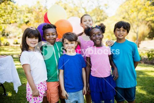 Cute children standing and posing during a birthday party