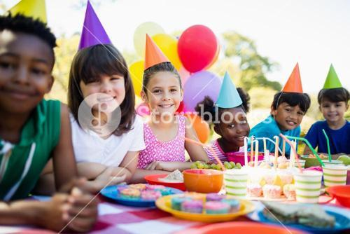 Cute children smiling and posing during a birthday party