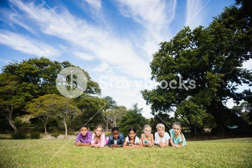 Smiling kids posing together during a sunny day