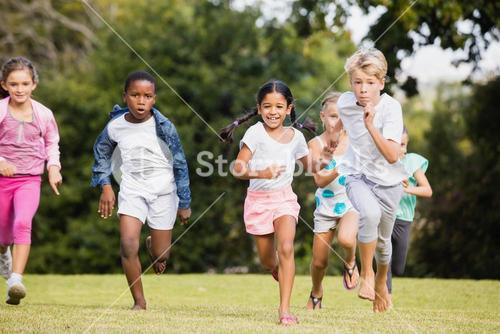 Kids playing together during a sunny day