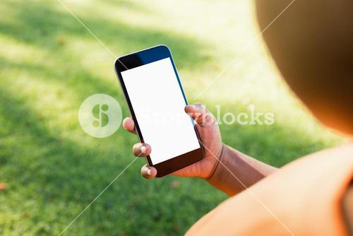 Kid using smartphone during a sunny day