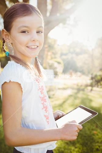 Kid using technology during a sunny day