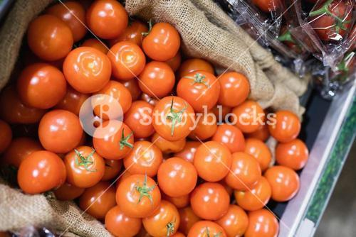 high angle view of tomatoes in shelf