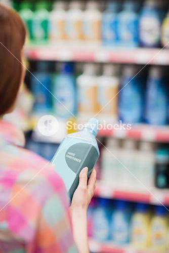 Rear view of woman holding detergent