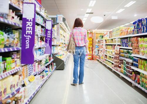 Rear view of woman standing in aisle