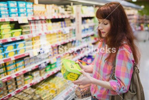 Serious woman choosing butter