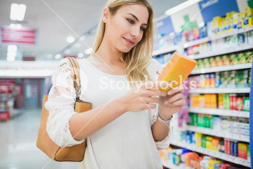Serious woman buying a product