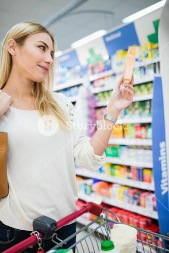 Profile view of woman holding a product