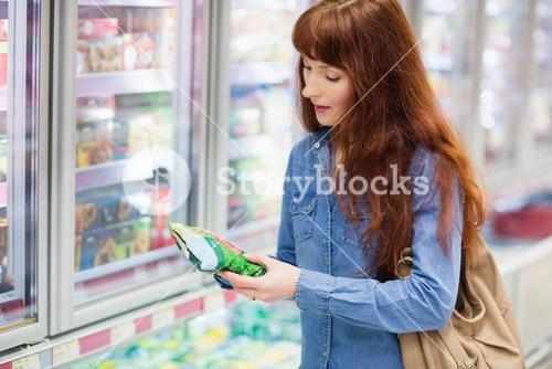 Customer picking a product in the frozen aisle