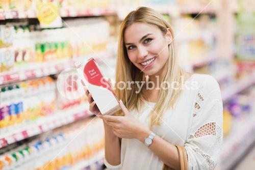 Smiling customer with a bottle of fruit juice