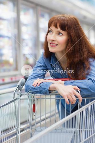 Smiling customer crossing the frozen aisle