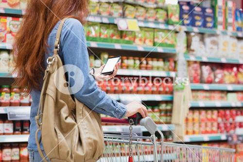 Customer in a store with a smartphone