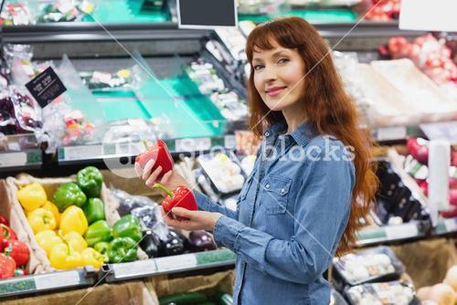 Smiling customer holding peppers