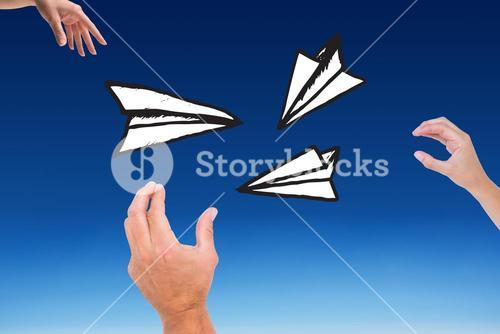 Composite of hands who are launching paper plane