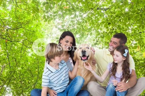 Composite image of happy family with a dog