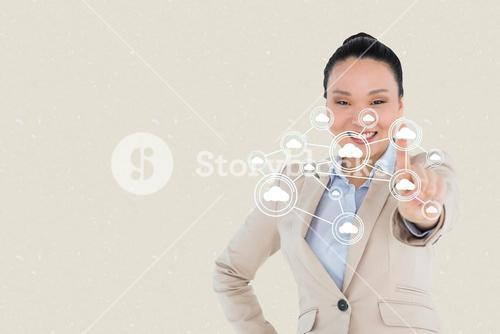 Composite image of businesswoman touching digital icons