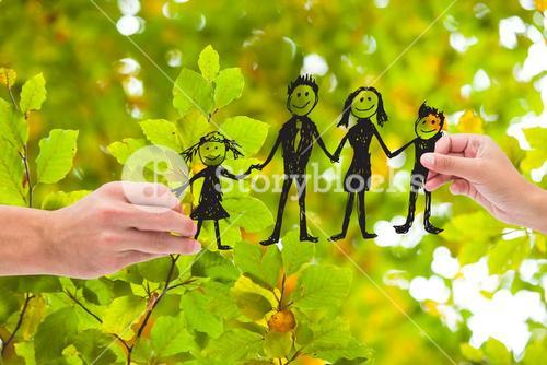 Composite image of people holding family diagram