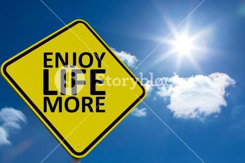 Composite image of enjoy life more message on a sign