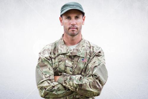 Composite image of an american soldier posing and crossed arms